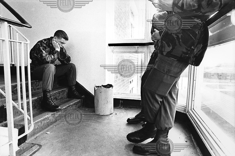 © Paul Smith / Panos Pictures..Warwickshire, England, UK...Teenage recruits undergoing Army Basic Training at Litchfield barracks. Private Trevor Sherman is missing his family. Shortly afterwards, he applied for Premature Voluntary Release, which is only available to those under 18, and left the army.