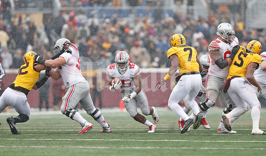 The offensive line opens up a hole for Ohio State Buckeyes running back Ezekiel Elliott (15) in the second half at TCF Bank Stadium on November 15, 2014. (Chris Russell/Dispatch Photo)