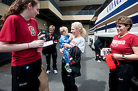 STANFORD, CA--Assistant Strength Coach Susan Borchardt prepares to board the team bus with her son Finley before traveling to Denver, CO for the 2012 NCAA Women's Final Four.