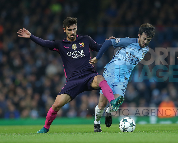 Andre Gomes of Barcelona tussles with David Silva of Manchester City during the Champions League Group C match at the Etihad Stadium, Manchester. Picture date: November 1st, 2016. Pic Simon Bellis/Sportimage