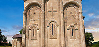 Pictures & images of Nikortsminda ( Nicortsminda ) St Nicholas Georgian Orthodox Cathedral exterior and its Georgian relief sculpture stonework of the west wall, 11th century, Nikortsminda, Racha region of Georgia (country). A UNESCO World Heritage Tentative Site.