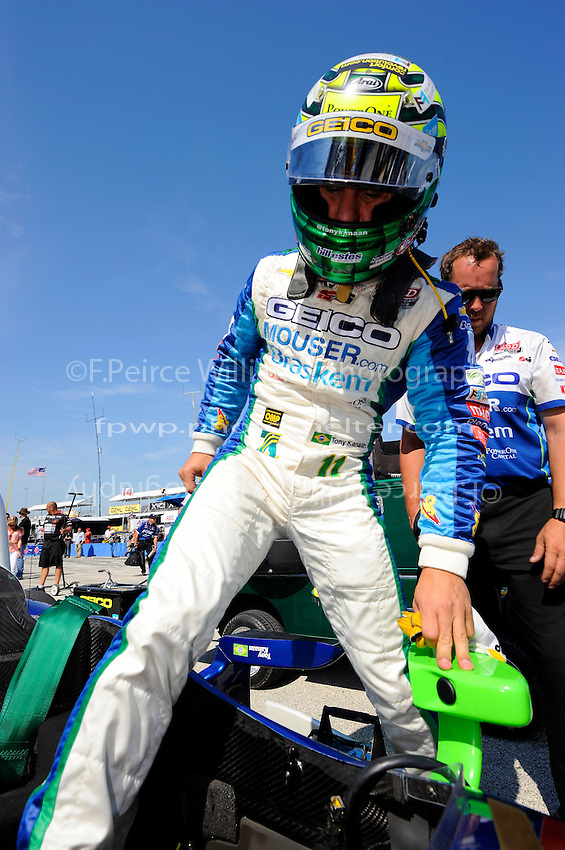 Tony Kanaan (#11) climbs into his car for qualifying.