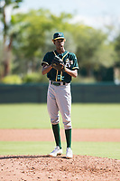 Oakland Athletics relief pitcher Wilkin Ramos (50) gets ready to deliver a pitch during an Instructional League game against the Los Angeles Dodgers at Camelback Ranch on October 4, 2018 in Glendale, Arizona. (Zachary Lucy/Four Seam Images)