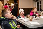 BETHLEHEM, CT. 07 December 2018-120718 - From left, The Lauretano kids Ryan, 6, Alexa, 4, and Olivia, 9, take a little dinner break inside before the lighting of the big tree during the annual Christmastown Festival on the Town Green in Bethlehem on Friday. Bill Shettle Republican-American