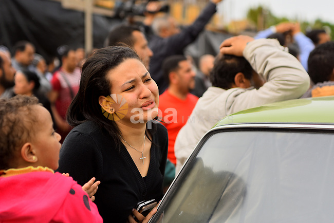 An Egyptian Christian woman mourns for the victims of the blast at the Coptic Christian Saint Mark's church in Alexandria the previous day during a funeral procession at the Monastery of Marmina in the city of Borg El-Arab, east of Alexandria on April 10, 2017. Egypt prepared to impose a state of emergency after jihadist bombings killed dozens at two churches in the deadliest attacks in recent memory on the country's Coptic Christian minority. Photo by Amr Sayed