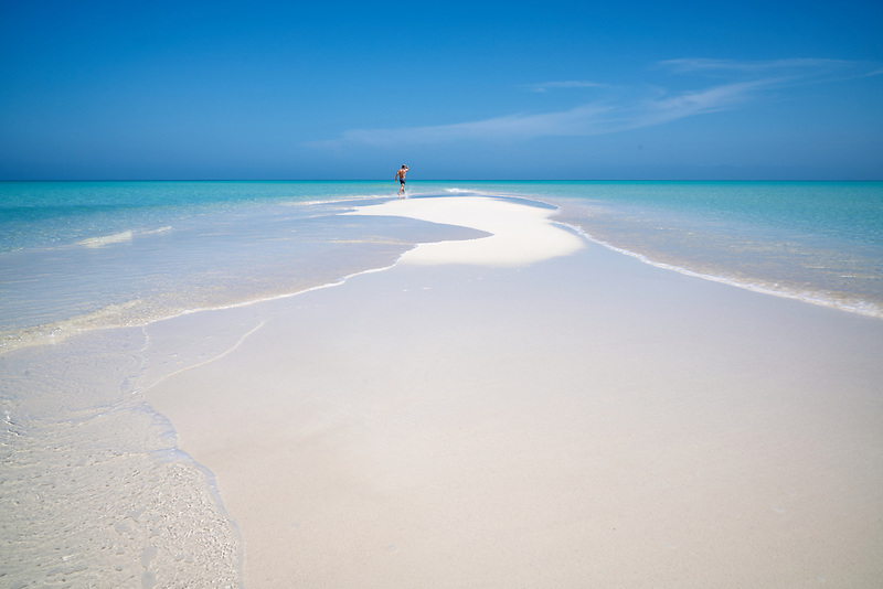 Man on samll sand island. Turks and Caicos. Providenciales