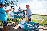 Tugun, Queensland Australia. (Friday March 21, 2014) –  Kelly Slater (USA) was presented with two checks this morning for Surfline's 2013 - 2014 Wave of the Winter and 2013 - 2014 US$10,000 Cliff Bar Overall Performance Award of the Winter. Sebastien Zietz (HAW), his girlfriend Christie  and Tommy Whitaker (AUS) surprised Kelly by jumping out from behind parked cars spraying him with soda water and presenting the US$25,000 Oakley Wave of the Winter check. Lachlan McKinnon (AUS) filmed the whole surpize. Photo: joliphotos.com