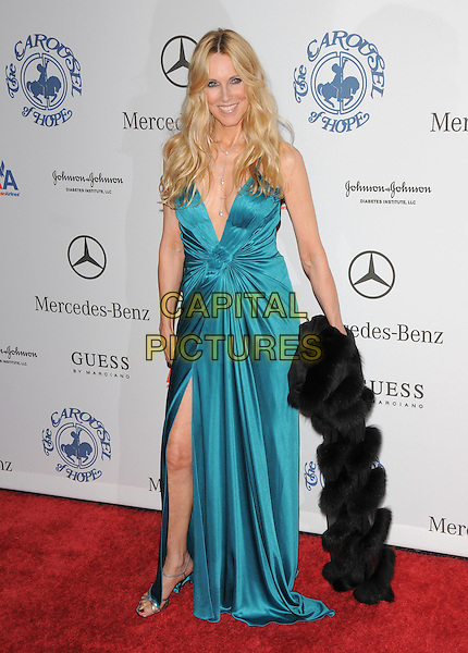 ALANA STEWART .attends The 30th Anniversary Carousel of Hope Ball Presented by Mercedes-Benz held at The Beverly Hilton Hotel in Beverly Hills, California, USA,.October 25th 2008..full length blue teal dress leg slit split long fur wrap .CAP/DVS.©Debbie VanStory/Capital Pictures