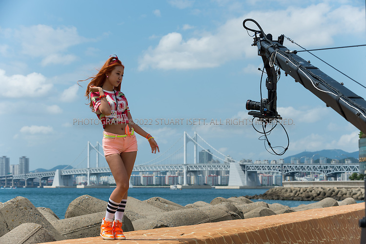 9/1/2013--Busan, South Korea<br /> <br /> The Korean k-pop band &quot;Tren-D&quot; film a video on Dongbaek Island Park in Busan (Pusan) with eth city skyline behind.<br /> <br /> Photograph by Stuart Isett<br /> &copy;2013 Stuart Isett. All rights reserved.