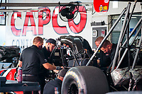 Jul 18, 2020; Clermont, Indiana, USA; Crew members work on the dragster of NHRA top fuel driver Steve Torrence during qualifying for the Summernationals at Lucas Oil Raceway. Mandatory Credit: Mark J. Rebilas-USA TODAY Sports