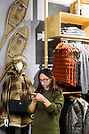 Guests mingle and look at clothing apparel and outdoor-outfitter gear during a grand opening event for Fjällräven Madison, a Swedish-heritage brand store in downtown Madison, Wis., on Oct. 22, 2015. Pictured is Samantha Bonizzi of Turner PR. (Photo by Jeff Miller - www.jeffmillerphotography.com)