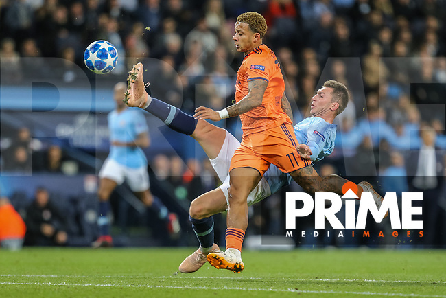 Aymeric LAPORTE of Manchester City and Memphis DEPAY of Olympique Lyonnais during the UEFA Champions League match between Manchester City and Olympique Lyonnais at the Etihad Stadium, Manchester, England on 19 September 2018. Photo by David Horn / PRiME Media Images.