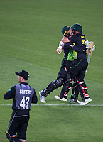 Australian batsmen Alex Carey and Aaron Finch celebrate the win after a world record run chase during the Black Caps v Australia international T20 cricket match at Eden Park in Auckland, New Zealand. 16 February 2018. Copyright Image: Peter Meecham / www.photosport.nz
