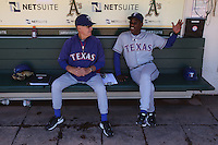 OAKLAND, CA - AUGUST 14:  Coach Jackie Moore #4 and manager Ron Washington #38 of the Texas Rangers talk in the dugout before the game against the Oakland Athletics at O.co Coliseum on August 14, 2011 in Oakland, California. Photo by Brad Mangin