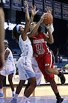 13 November 2015: Gardner-Webb's Olivia Parker (11) and North Carolina's N'Dea Bryant (22). The University of North Carolina Tar Heels hosted the Gardner-Webb University Runnin' Bulldogs at Carmichael Arena in Chapel Hill, North Carolina in a 2015-16 NCAA Division I Women's Basketball game. Gardner-Webb won the game 66-65.