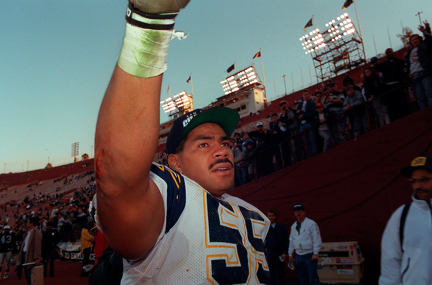 San Diego Chargers linebacker Junior Seau waves to fans after a game in 1993.  Seau is considered one of the best players to never win a Super Bowl, and is notable for his 12 career Pro Bowl selections and 16 seasons for the San Diego Chargers, Miami Dolphins and the New England Patriots.