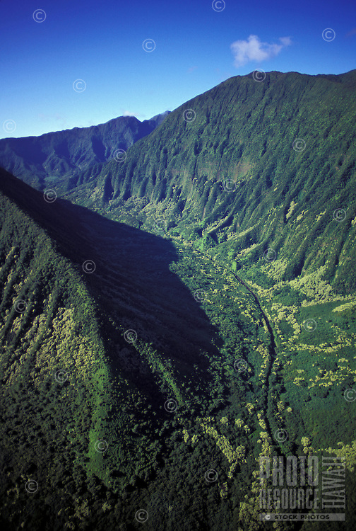 Aerial of the Pali Highway as it runs through Nuuanu Valley, with a view of the Koolau Mountains