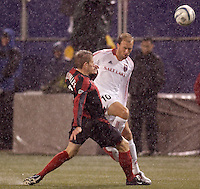 The MetroStars' John Wolyniec tackles the ball away from Clint Mathis of Real Salt Lake. The weather was the story with 50 mph winds, rain, and a brief power outage as the MetroStars played Real Salt Lake to a scoreless tie during opening day action of season 10 of the MLS at Giant's Stadium, East Rutherford, on Saturday April 2, 2005.
