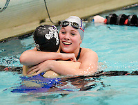McFarland's Alexandra Moderski (R) is congratulated by Edgewood's Kaitlyn Barth on setting a state record in the 50-yard freestyle with a time of 22.84 seconds, during the WIAA Division 2 girls state swim & dive championship on Friday, November 13, 2015 at the UW Natatorium in Madison, Wisconsin