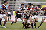 Luke Mealamu looks for support during the Air NZ Cup game between the Counties Manukau Steelers and Southland played at Mt Smart Stadium on 3rd September 2006. Counties Manukau won 29 - 8.
