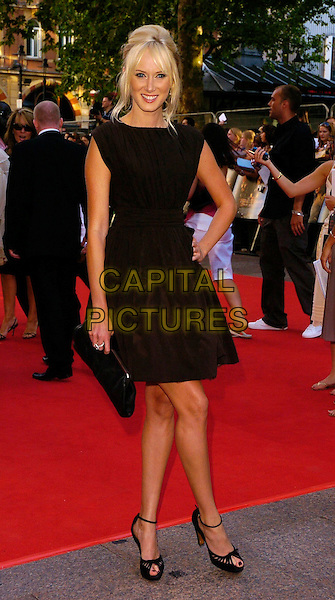 "KIMBERLEY STEWART.The ""Pirates of the Caribbean: Dead Man's Chest"" European premiere, Odeon Leicester Square, London, UK..July 3rd, 2006.Ref: CAN.full length Kimberly black dress sleeveless clutch purse.www.capitalpictures.com.sales@capitalpictures.com.©Capital Pictures"