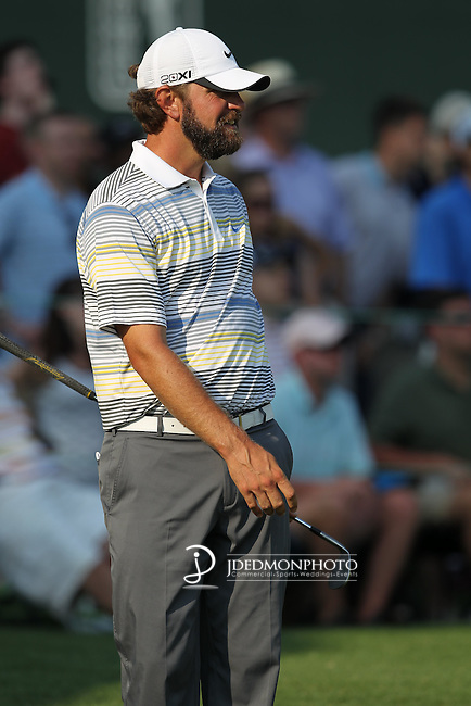 May 8,2011 - Lucas Glover eyes his putts progress towards the cup.  Lucas Glover wins the tournament in sudden death over Jonathan Byrd at Quail Hollow Country Club,Charlotte,NC.
