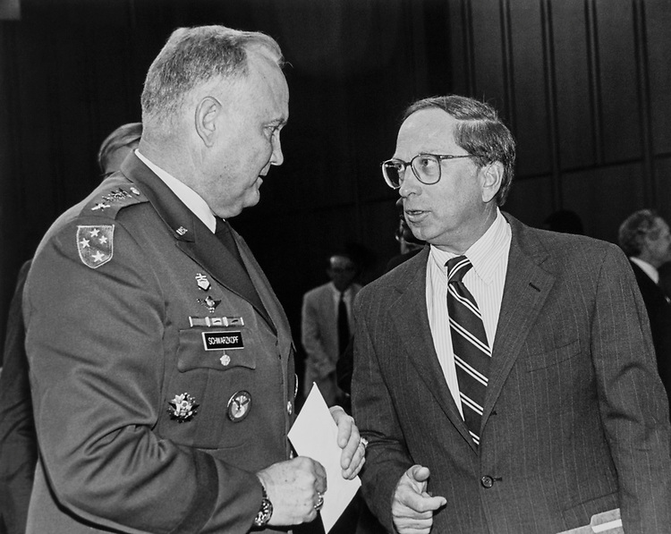 Sen. Sam Nunn, D-Ga. talking with General H. Norman Schwarzkopf after testifying before Senate Armed Service commence. June 12, 1991. (Photo by Maureen Keating/CQ Roll Call)