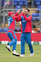 Hashmatullah Shahidi  (Afghanistan)jumps for joy and congratulates Mohammad Nabi (Afghanistan) on the wicket of Lahiru Thrimanne (Sri Lanka) during Afghanistan vs Sri Lanka, ICC World Cup Cricket at Sophia Gardens Cardiff on 4th June 2019