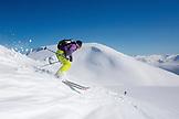 sVALBARD, Longyearban, Skiers coming down Glacier Andreebreen toward Liefde Fjord