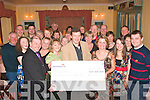 8851-8858.CHARITY ACT: John Murray, Chairman of Oisiri (Spa community drama group) presents a cheque for EUR2,500 to John Brennan of Dochas to help Build/renovate! the local community hall in the Spa on Friday night in the Oyster Tavern.