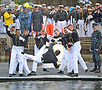 Participating in an annual May ritual, Midshipmen Dan Ryan is tossed into the water of the Santee Basin by the Plebes in his company after the Commencement Week Color Parade at the United States Naval Academy.