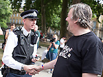 """© Joel Goodman - 07973 332324 . 10/08/2013 . London , UK . A policeman asks for his photo to be taken with Stephen Fry at the demonstration . Protesters with placards . Demonstration against homophobic laws being enacted in Russia on Whitehall this afternoon (10th August 2013) . Legislation includes banning gay pride events for100 years , banning the distribution of """" propaganda of non-traditional sexual relations """" to minors , making it illegal for the adoption of Russian children by gay couples or any single person who comes from a country that recognises marriage equality and giving authorities the rights to arrest foreign nationals whom they suspect are LGBT or pro gay with the right to detain them for up to 14 days. Photo credit : Joel Goodman"""