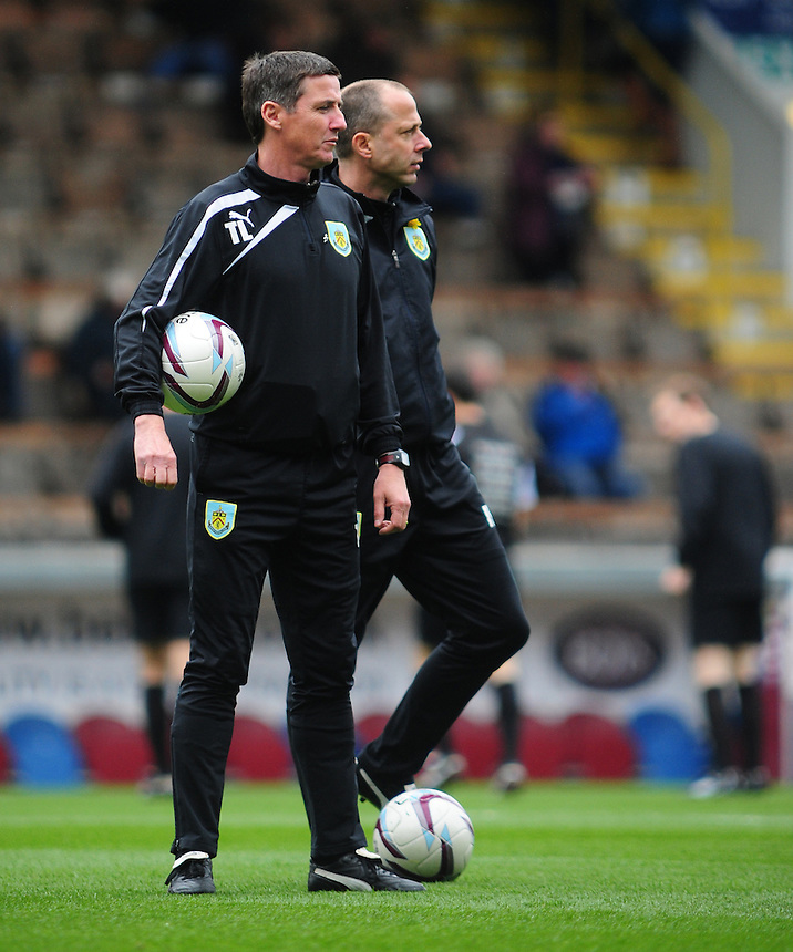 Burnley's First Team Coach Tony Loughlan , left, and Burnley's Assistant Manager Ian Woan during the pre-match warm-up <br /> <br /> Photo by Chris Vaughan/CameraSport<br /> <br /> Football - The Football League Sky Bet Championship - Burnley v Middlesbrough - Saturday 12th April 2014 - Turf Moor - Burnley<br /> <br /> &copy; CameraSport - 43 Linden Ave. Countesthorpe. Leicester. England. LE8 5PG - Tel: +44 (0) 116 277 4147 - admin@camerasport.com - www.camerasport.com