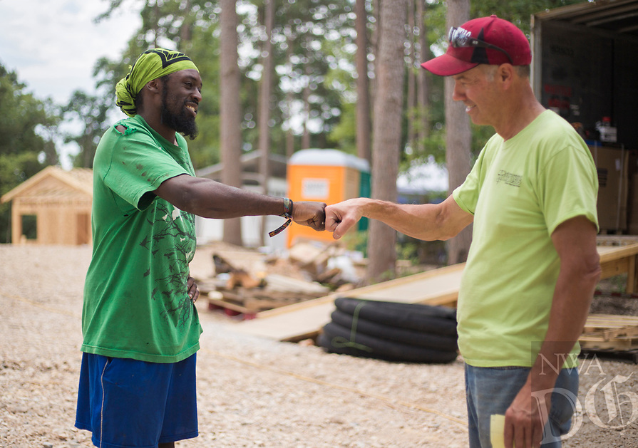 NWA Democrat-Gazette/CHARLIE KAIJO (From left) Asee Mason of Eureka fistbumps Dr. Dan Bell, Friday, June 8, 2018 on Passion Play Road, across the street from the Washington Regional clinic in Eureka Springs. <br />