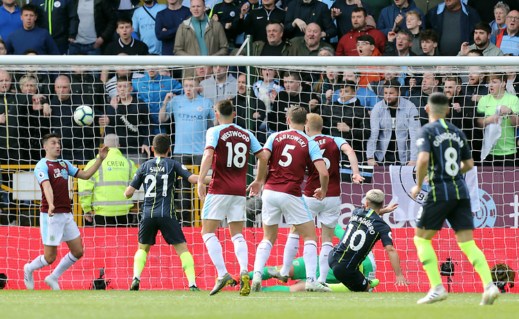 Burnley's Matthew Lowton fails to prevent a strike from Manchester City's Sergio Aguero crossing the line for the opening goal<br /> <br /> Photographer Rich Linley/CameraSport<br /> <br /> The Premier League - Burnley v Manchester City - Sunday 28th April 2019 - Turf Moor - Burnley<br /> <br /> World Copyright © 2019 CameraSport. All rights reserved. 43 Linden Ave. Countesthorpe. Leicester. England. LE8 5PG - Tel: +44 (0) 116 277 4147 - admin@camerasport.com - www.camerasport.com