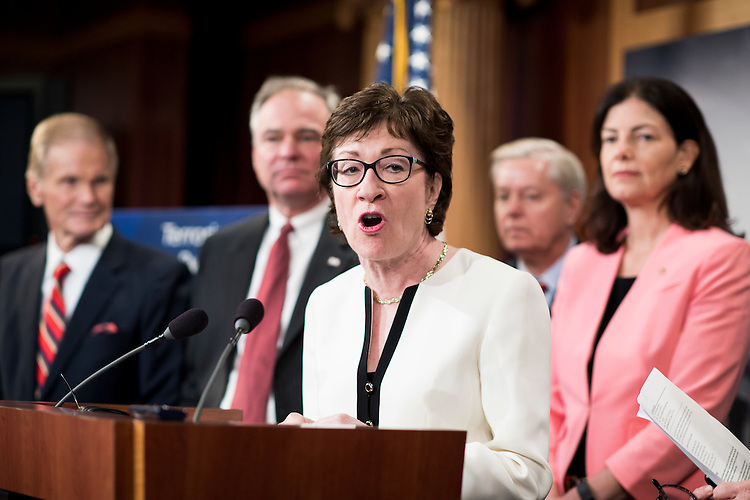 UNITED STATES - JUNE 21: Sen. Susan Collins (R-ME) speaks during the press conference on bipartisan gun control legislation on Tuesday, June 21, 2016. . Behind Sen. Collins from left are Sen. Bill Nelson (D-FL) Sen. Tim Kaine (D-VA) Sen. Lindsey Graham (R-SC) and Sen. Kelly Ayotte (R-NH). (Photo By Bill Clark/CQ Roll Call)