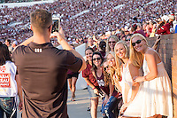 Game Day: MSU Football versus South Carolina.<br /> Fans pose for picture<br />  (photo by Robert Lewis / &copy; Mississippi State University)