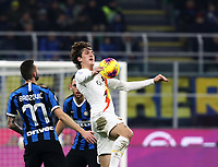 Calcio, Serie A: Inter Milano - AS Roma, Giuseppe Meazza stadium, December 6, 2019.<br /> Roma's Nicolò Zaniolo (r) in action with Inter's Marcelo Brozovic (l) during the Italian Serie A football match between Inter and Roma at Giuseppe Meazza (San Siro) stadium, on December 6, 2019.<br /> UPDATE IMAGES PRESS/Isabella Bonotto