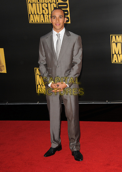 LEWIS HAMILTON.The 2008 American Music Awards held at Nokia Theatre L.A. Live in Los Angeles, California, USA. .November 23rd, 2008 .ama amas ama's arrivals full length suit  grey gray .CAP/DVS.©Debbie VanStory/Capital Pictures.