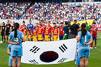 Korea Republic (KOR) players during the playing of the Korean national anthem. The women's national team of the United States defeated the Korea Republic 5-0 during an international friendly at Red Bull Arena in Harrison, NJ, on June 20, 2013.