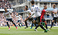 Mousa Dembele of Tottenham Hotspur (centre) celebrates scoring his side's first goal during the Premier League match between Tottenham Hotspur and Bournemouth at White Hart Lane, London, England on 15 April 2017. Photo by Mark  Hawkins / PRiME Media Images.