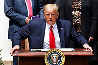 United States President Donald J. Trump takes a seat to sign H.R. 7010 - PPP Flexibility Act of 2020 in the Rose Garden of the White House in Washington, DC on June 5, 2020. <br /> Credit: Yuri Gripas / Pool via CNP/AdMedia