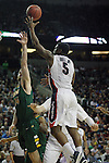 Gonzaga's Gary Bell (5) leaps to hit a jump shot while being guarded by North Dakota State's Chris Kading (34) during the 2015 NCAA Division I Men's Basketball Championship's March 20, 2015 at the Key Arena in Seattle, Washington.   ©2015. Jim Bryant Photo. ALL RIGHTS RESERVED.