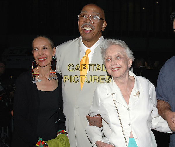 "CARMEN DE LAVALLADE, GEOFFREY HOLDEN & CELESTE HOLM.Arrives at the ""Proof"" Premiere st Ziegfeld Theater,.New York, 13th September 2005.half length wife husband white jacket grey gray suit.Ref: ADM/PO.www.capitalpictures.com.sales@capitalpictures.com.© Capital Pictures."