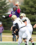 SIOUX FALLS, SD - OCTOBER 18: Jarrett Grabbe #97 from the University of Sioux Falls knocks down the pass attempt by Charlie Kern #7 from Southwest Minnesota State in the first half of their game Saturday afternoon at Bob Young Field in Sioux Falls. (Photo by Dave Eggen/Inertia)