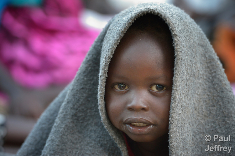 Early in the morning in a camp for over 5,000 internally displaced persons in an Episcopal Church compound in Wau, South Sudan, a child wakes up, covering their head with a blanket. Most of the families here were displaced by violence early in 2017, after a larger number took refuge in other church sites when widespread armed conflict engulfed Wau in June 2016.<br /> <br /> Norwegian Church Aid, a member of the ACT Alliance, has provided relief supplies to the displaced in Wau, and has supported the South Sudan Council of Churches as it has struggled to mediate the conflict in Wau.