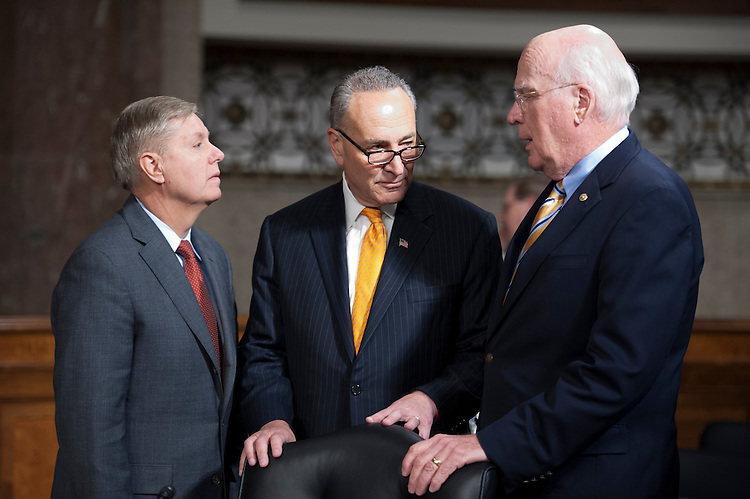 UNITED STATES - May 14: Sen. Lindsey Graham, R-SC., Sen. Charles Schumer, D-NY., and Chairman Pat Leahy, D-Vt.,  talk prior to the start of the Senate Judiciary Committee hearing on the continued consideration of the border security, economic opportunity and immigration modernization act on Capitol Hill May 14, 2013 in Washington, DC. The 18 members of the committee have proposed in excess of 300 amendments to the 844 page piece of legislation that would, if passed, create a path to U.S. citizenship for undocumented immigrants. (Photo By Douglas Graham/CQ Roll Call)