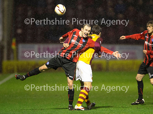 Motherwell v St Johnstone.....01.01.14   SPFL<br /> Dave Mackay battles with John Sutton<br /> Picture by Graeme Hart.<br /> Copyright Perthshire Picture Agency<br /> Tel: 01738 623350  Mobile: 07990 594431