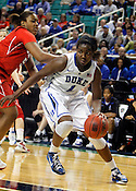 Elizabeth Williams goes in for 2 of her 12 total points. NC State defeated Duke 75-73 during quarter finals of the 2012 ACC Women's Basketball Tournament at the Greensboro Coliseum in Greensboro, NC. Photo by Al Drago.