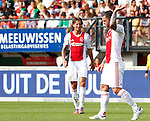 Nederland, Nijmegen, 19 augustus 2012.Eredivisie.Seizoen 2012-2013.N.E.C.-Ajax (1-6).Theo Janssen (r.) van Ajax maakt een wegwerpgebaar. Links Mitchell.Dijks van Ajax